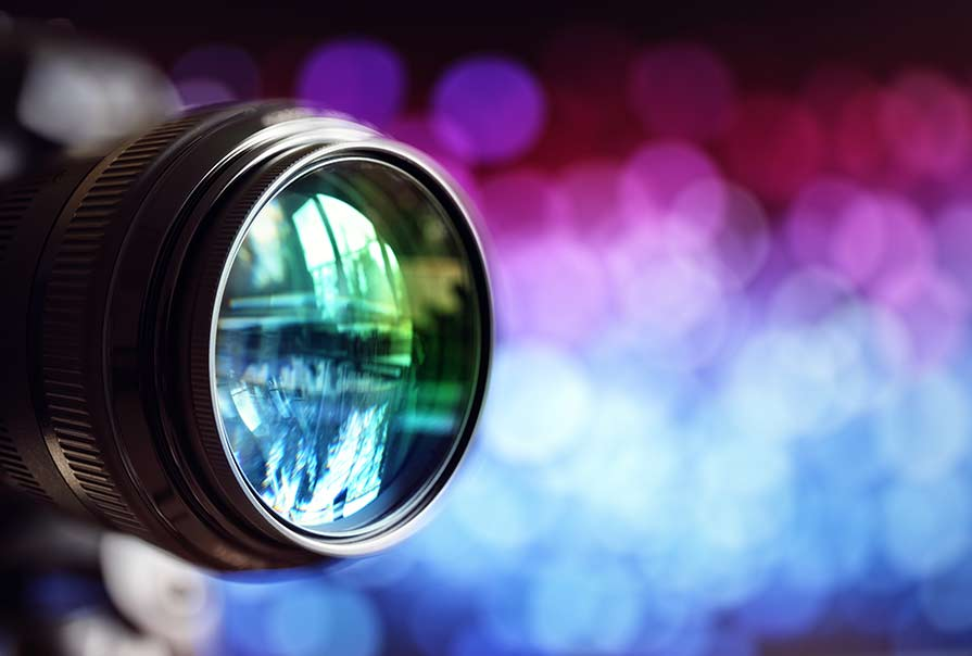 Camera lens against a bunch of cool colors
